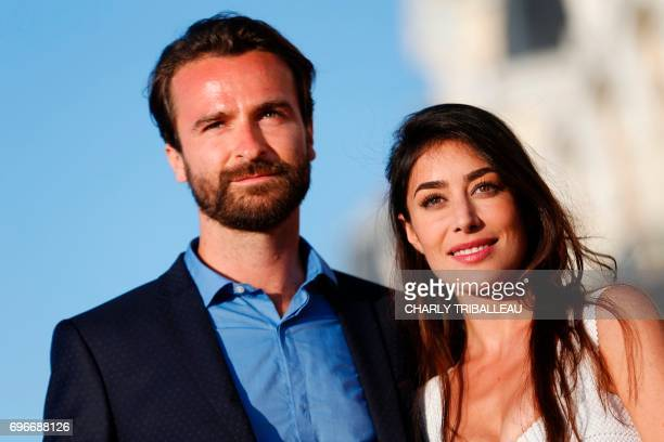 French actors Fanny Valette and Amaury de Crayencour pose on the red carpet on June 16 2017 during the Cabourg Romantic Film Festival in Cabourg...