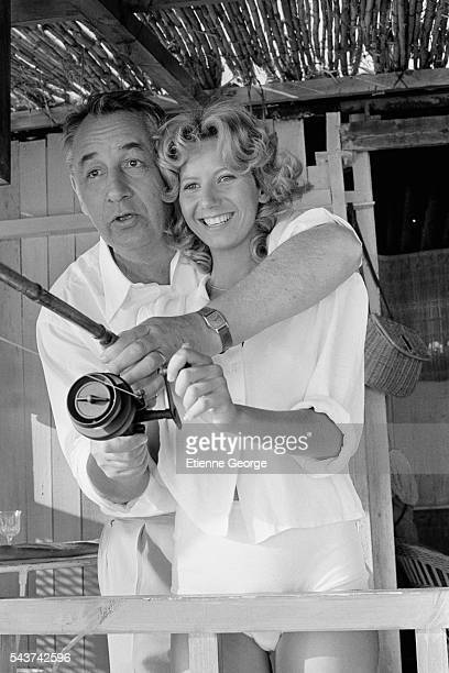 French actors Fiona Gélin and Philippe Noiret on the set of the film 'Le Grand carnaval' directed by Alexandre Arcady