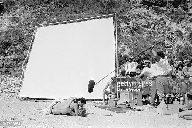 French actors Fiona Gélin and Richard Berry on the set of the film 'Le Grand carnaval' directed by Alexandre Arcady alongside cinematographer Yves...