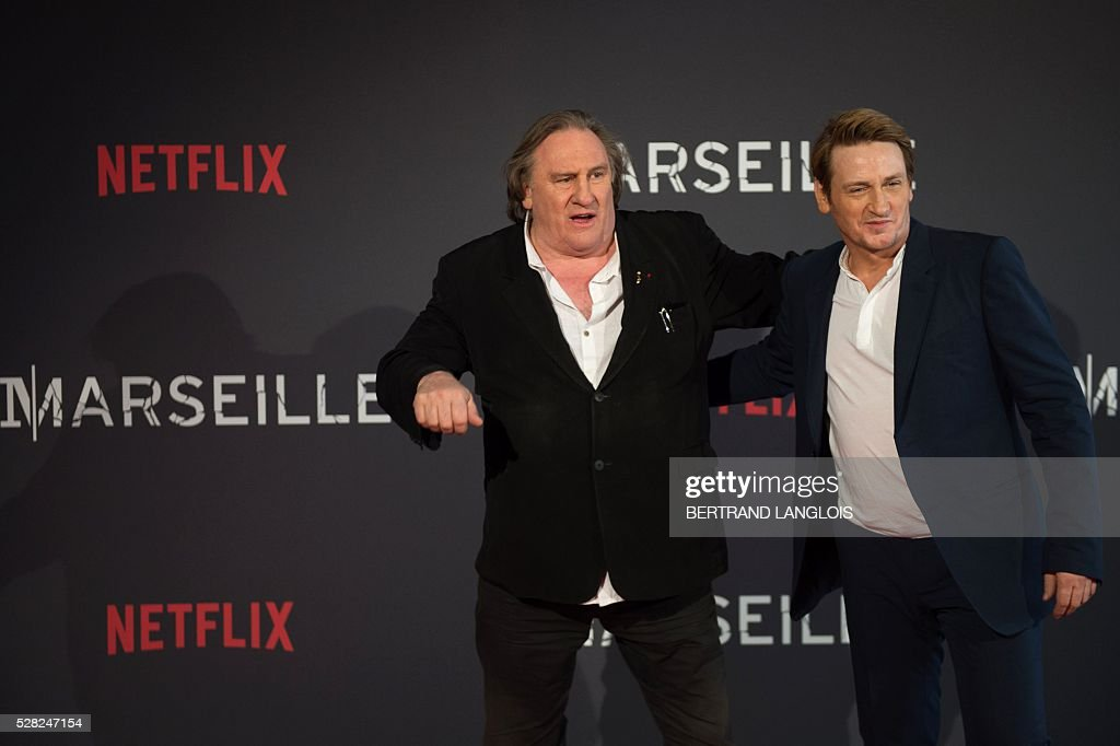 French actors Gerard Depardieu (L) and Benoit Magimel pose during a photocall for the premiere of the French TV show 'Marseille' broadcasted and co-produced by Netflix on May 4, 2016 in Marseille, southern France. / AFP / BERTRAND