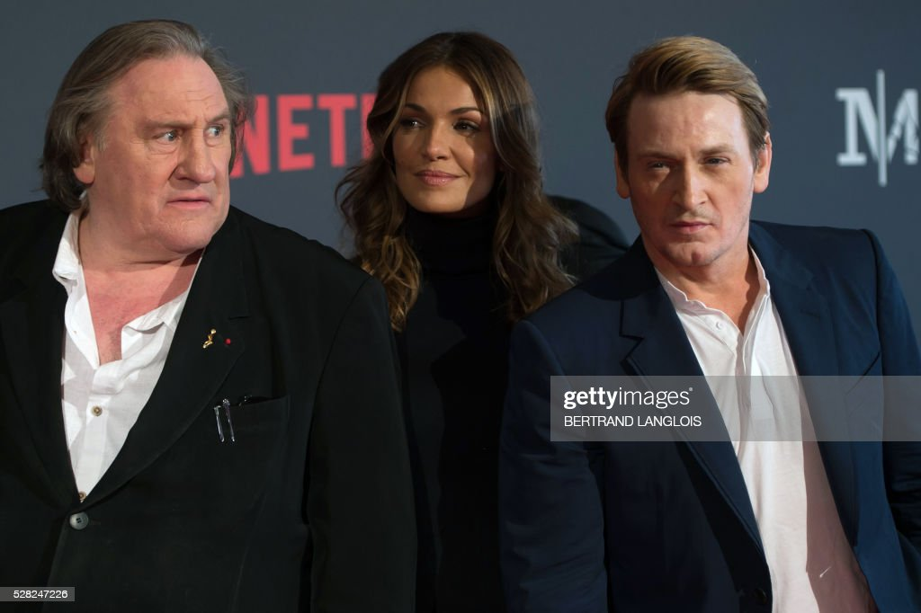 French actors Gerard Depardieu, Nadia Fares and Benoit Magimel pose during a photocall for the premiere of the French TV show 'Marseille' broadcasted and co-produced by Netflix on May 4, 2016 in Marseille, southern France. / AFP / BERTRAND
