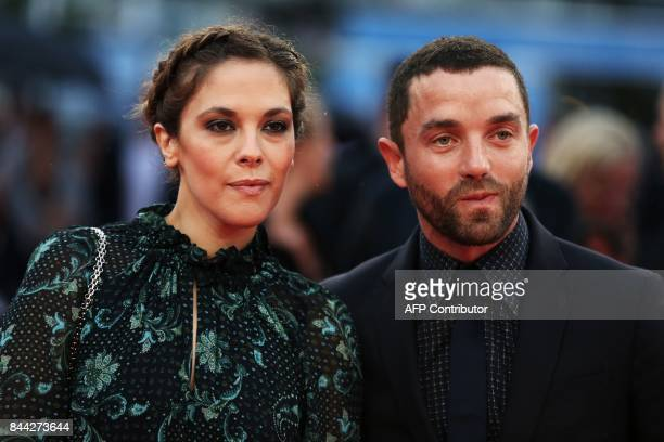 French actors Guillaume Gouix and Alysson Paradis pose on the red carpet before the screening of the movie 'Mother' on September 8 2017 in the...