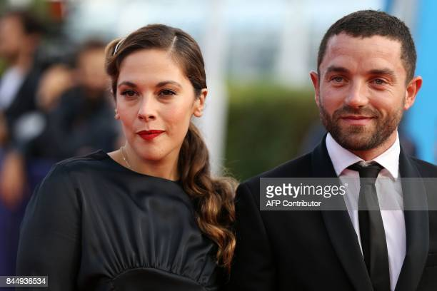 French actors Guillaume Gouix and Alysson Paradis pose on the red carpet before the closing ceremony of the 43rd Deauville US Film Festival on...