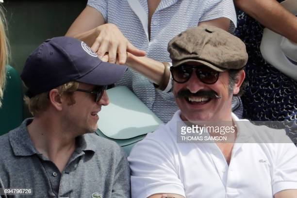 French actors Jean Dujardin and Guillaume Canet attend the final tennis match between Spain's Rafael Nadal and Switzerland's Stanislas Wawrinka at...