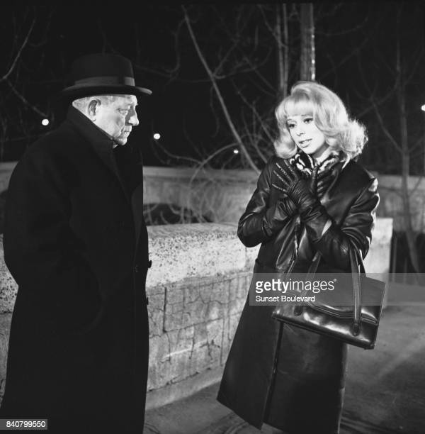 French actors Jean Gabin and Mireille Darc on the set of Monsieur directed by JeanPaul Le Chanois/ Les Films Copernic / Les Films Corona