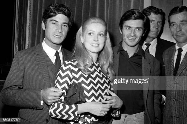 French actors JeanClaude Brialy Catherine Deneuve and Sami Frey are seen during a reception before the filming of 'Manon 70' directed by Jean Aurel...