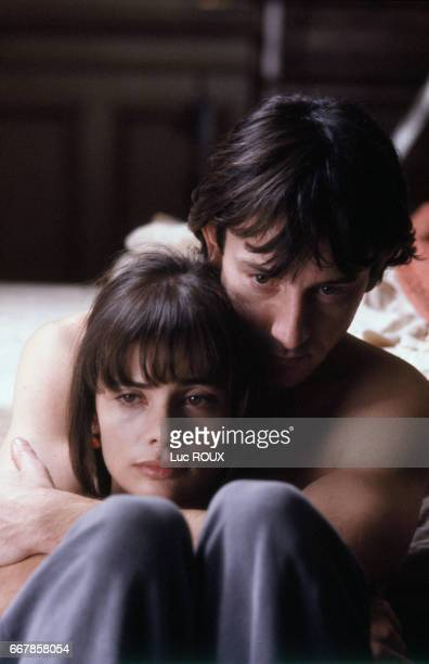 French actors JeanHugues Anglade and Marie Trintignant on the set of the film Nuit d'Ete en Ville directed by Michel Deville