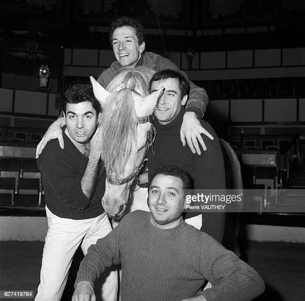 French actors JeanMarc Thibault JeanPierre Cassel Roger Pierre and Claude Brasseur gather around a horse