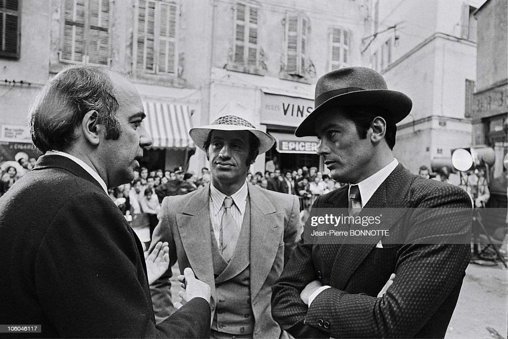 French actors <a gi-track='captionPersonalityLinkClicked' href=/galleries/search?phrase=Jean-Paul+Belmondo&family=editorial&specificpeople=207029 ng-click='$event.stopPropagation()'>Jean-Paul Belmondo</a>, <a gi-track='captionPersonalityLinkClicked' href=/galleries/search?phrase=Alain+Delon&family=editorial&specificpeople=228460 ng-click='$event.stopPropagation()'>Alain Delon</a> (R) and director Jacques Deray (L) on the set of gangster movie Borsalino in 1970 in Paris, France.