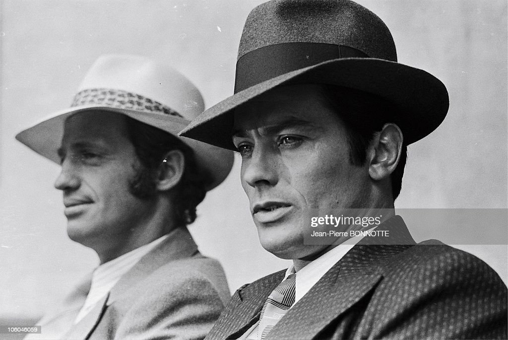 French actors Jean-Paul Belmondo and Alain Delon (R) on the set of gangster movie Borsalino, directed by Jacques Deray, in 1970 in Paris, France.