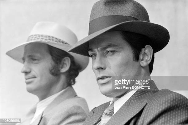 French actors JeanPaul Belmondo and Alain Delon on the set of gangster movie Borsalino directed by Jacques Deray in Paris France in September 1969