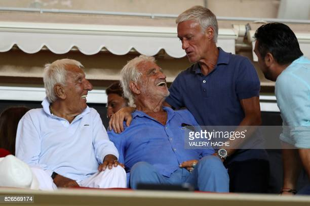 French actors JeanPaul Belmondo and Charles Gerard talk with French national football team's coach Didier Deschamps during the French football match...
