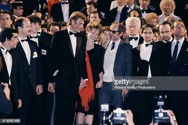 French actors Johnny Hallyday Nathalie Baye and Claude Brasseur attend the 37th Cannes Film Festival to present the movie Detective directed by...