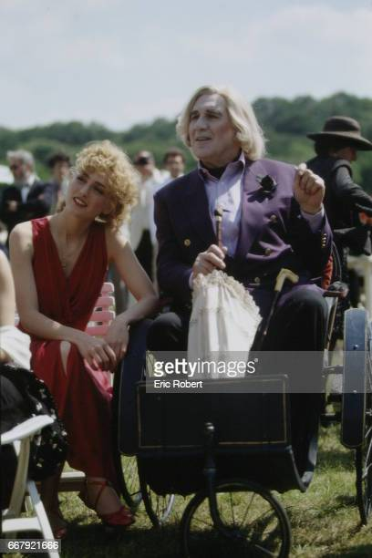 LR French actors Michel Piccoli Julie Gayet on the set of the film 'Les Cent et une nuits de Simon Cinéma' directed by French director Agnes Varda