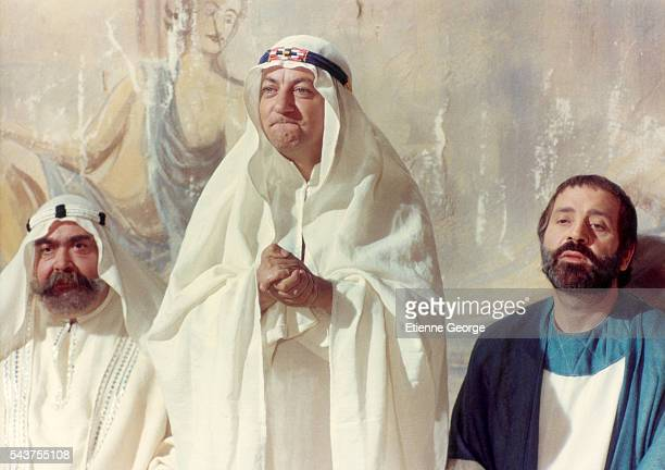 French actors Mr Moustache Coluche and French director and actor Jean Yanne on the set of Yanne's film 'Deux Heures Moins le Quart avant JesusChrist'...