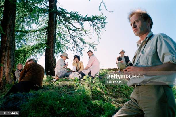 French actors Niels Arestrup Michel Aumont Stephane Audran Judith Magre Carole Bouquet and Philippe Noiret with director Didier Martiny on the set of...