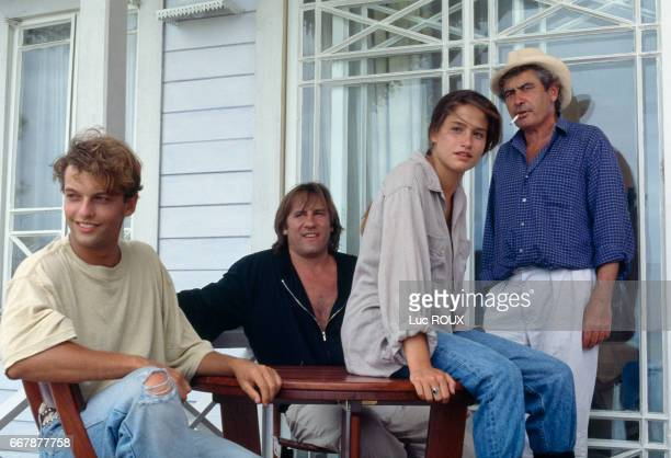 French actors Patrick Mille and Gerard Depardieu, Belgian actress Marie Gillain with director and screenwriter Gerard Lauzier on the set of his movie Mon pere, ce heros (My Father the Hero).