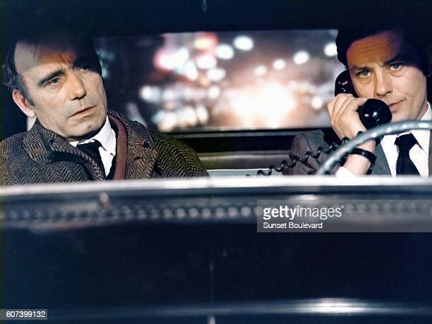 French actors Paul Crauchet and Alain Delon on the set of Un Flic written and directed by JeanPierre Melville
