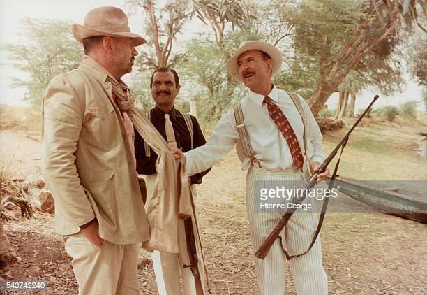 French actors Philippe Noiret Gérard Hernandez and JeanPierre Marielle on the movie set of 'Coup de torchon' directed by Bertrand Tavernier