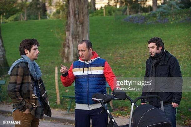 French actors Raphaël Personnaz and Jérôme Commandeur with actor director and screenwriter Clément Michel on the set of his movie La Stratégie de la...