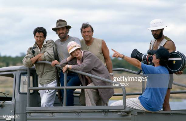 French actors Richard Anconina JeanPaul Belmondo and MarieSophie L and director Claude Lelouch on the set of Lelouch's film Itineraire d'un Enfant...