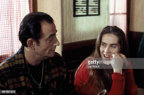 French actors Richard Bohringer and Emmanuelle Seigner on the set of the film Le Sourire directed by Claude Miller