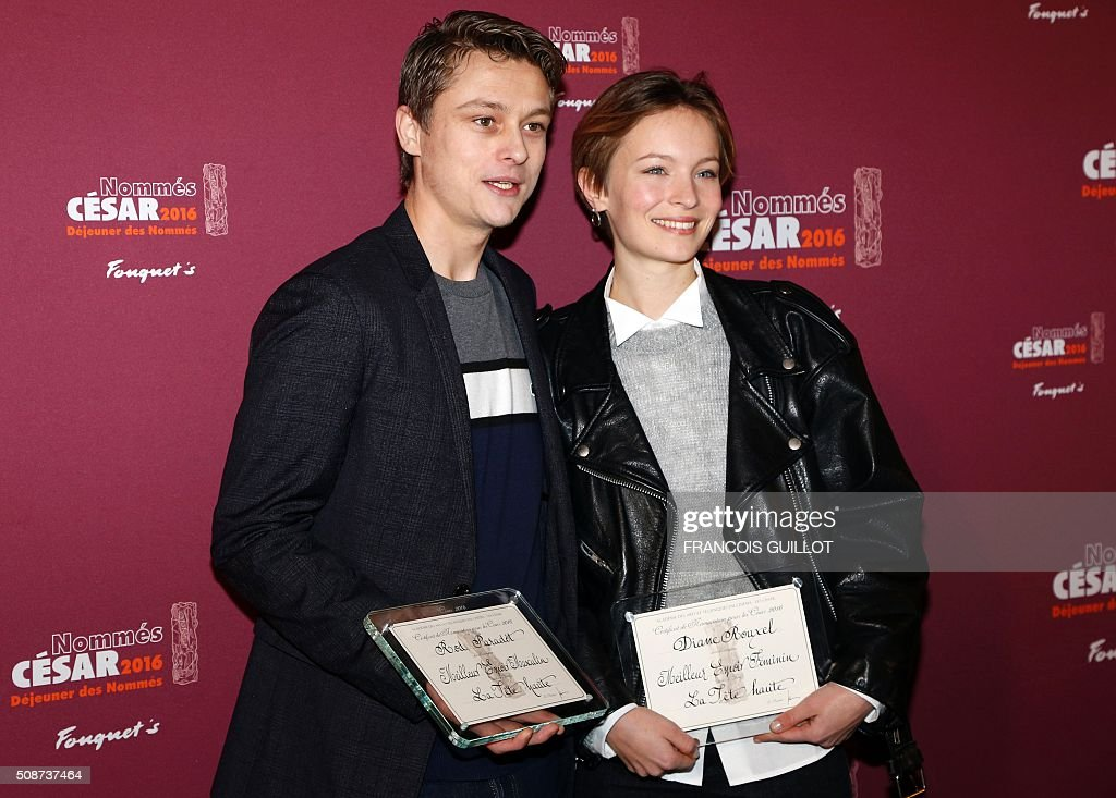 French actors Rod Paradot (L) et Diane Rouxel pose with their nomination certificates for Best Male and Female Newcomer during the nominations event for the 2016 César film awards, on February 6, 2016 in Paris. The 41st Ceremony for the Cesar film award, considered as the highest film honour in France, will take place on February 26, 2016. / AFP / FRANCOIS GUILLOT