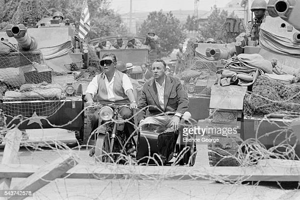 French actors Roger Hanin and Philippe Noiret on the set of the film 'Le Grand carnaval' directed by Alexandre Arcady