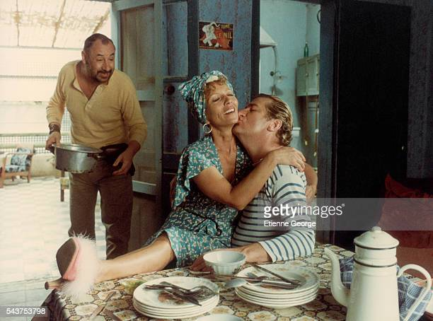 French actors Stéphane Audran Eddy Mitchell and Philippe Noiret on the movie set of 'Coup de torchon' directed by Bertrand Tavernier
