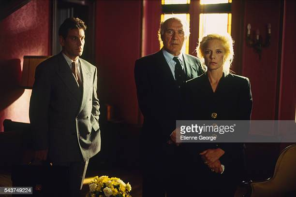 French actors Tcheky Karyo and Michel Piccoli with French singer and actress Sylvie Vartan on the set of the film 'L'Ange Noir' directed by French...