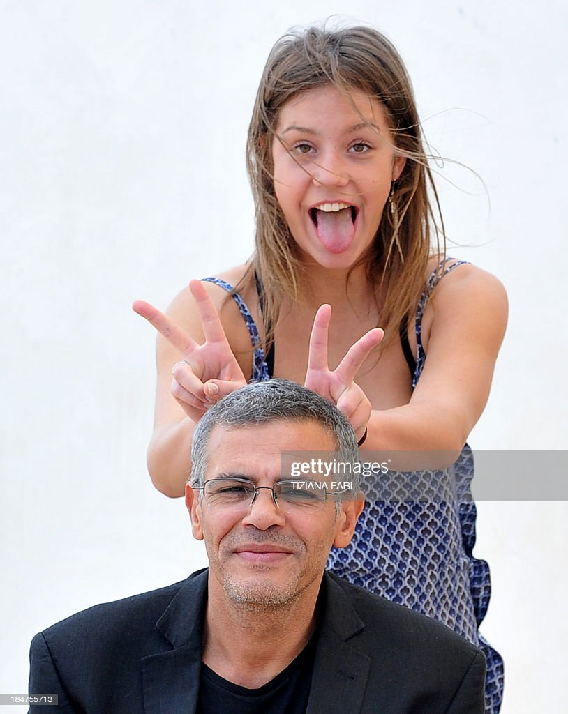 French actress Adele Exarchopoulos jokes with French director Abdellatif Kechiche during a photocall to promote the release of the movie 'La Vita di Adele' (Blue Is the Warmest Colour - La Vie d'Adele) on October 16, 2013 in Rome.