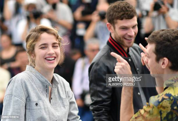 French actress Adele Haenel Argentinian actor Nahuel Perez Biscayart and French actor Arnaud Valois laugh on May 20 2017 during a photocall for the...