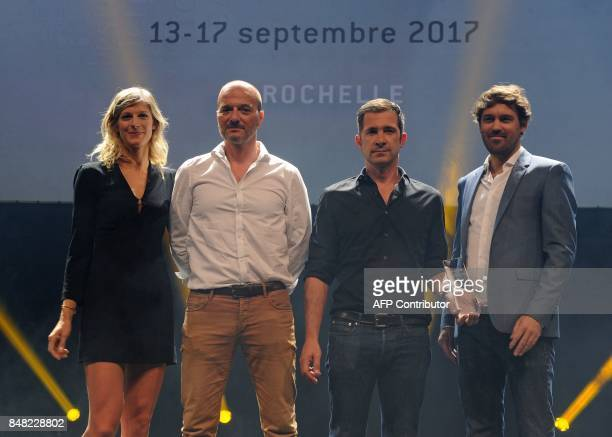 French actress Alexia Barlier and crew members of the TV film 'La foret' pose after receiving the best serie 52' award during closing ceremony of the...