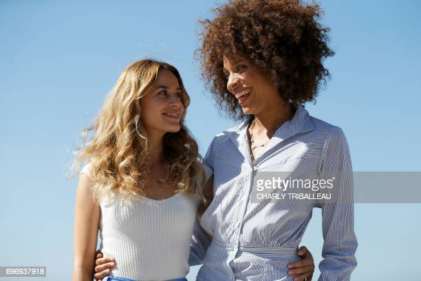French actress Alice David and French actress and singer Stefi Celma pose during a photocall for the Cabourg Romantic Film Festival in Cabourg...