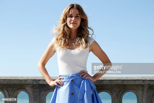 French actress Alice David poses during a photocall for the Cabourg Romantic Film Festival in Cabourg northwestern France on June 17 2017 / AFP PHOTO...
