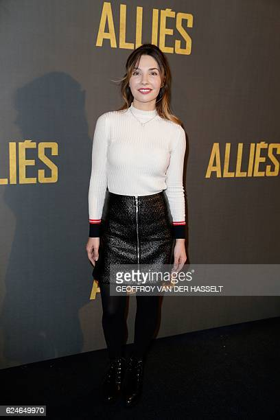 French actress Alix Benezech poses as she arrives for the premiere of the film 'Allied' on November 20 2016 in Paris / AFP / GEOFFROY VAN DER HASSELT