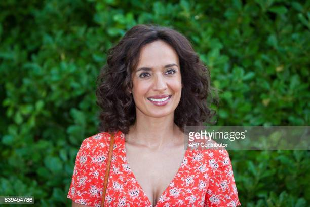 French actress Amelle Chahbi poses during a photocall for the film 'Coexister' at the 10th Francophone Angouleme Film Festival on August 26 2017 in...