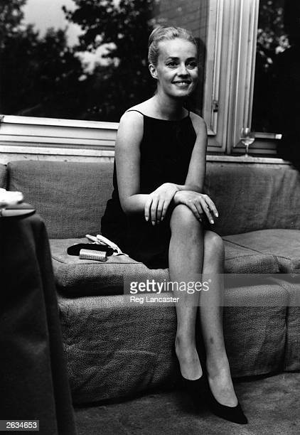 French actress and director Jeanne Moreau announces her marriage to fashion designer Pierre Cardin at a press conference