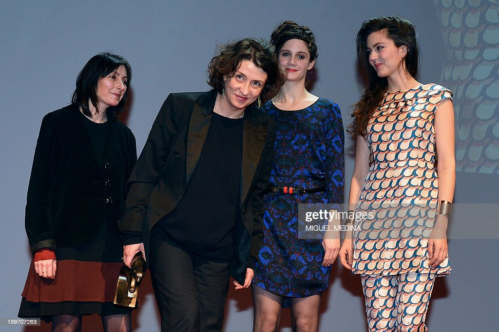 French actress and director Noemy Lvovsky (2ndL) poses next to French actresses Julia Faure (R) and Judith Chemla (2ndR) after receiving the special award for her movie 'Camille redouble' during the 18th Lumieres awards ceremony, on January 18, 2013 at the Gaite Lyrique in Paris. International media journalists based in Paris from around 50 countries vote each year to award their own prizes to members of the French and francophone film industry. The Academy of the Lumieres paid this year a tribute to foreign actresses in French cinema and organised for the first time, the day before, the 'Francophone meetings' with hosted Tunisia, during which Tunisian director, Ferid Boughedir gave a masterclass. AFP PHOTO MIGUEL MEDINA