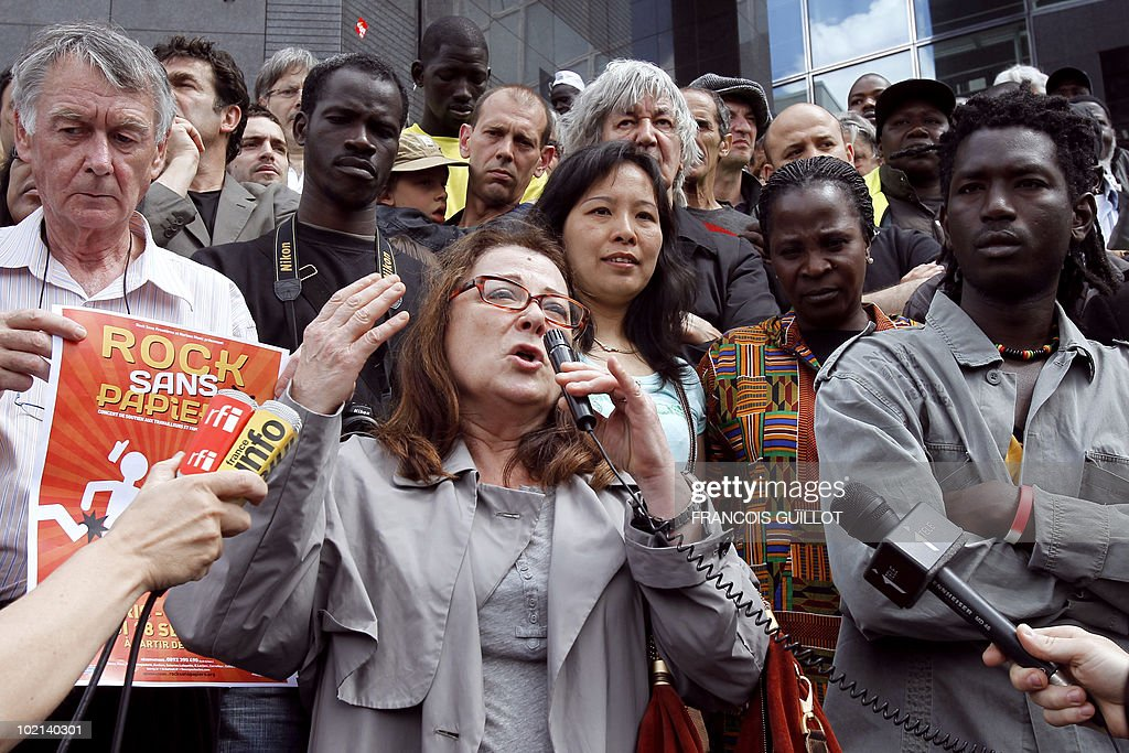 French actress and film director Josiane Balasko (C) speaks during a demonstration of illegal immigrant workers calling for their regularization on June 6, 2010 in front of the Opera Bastille in Paris. Background, French singer Jacques Higelin.