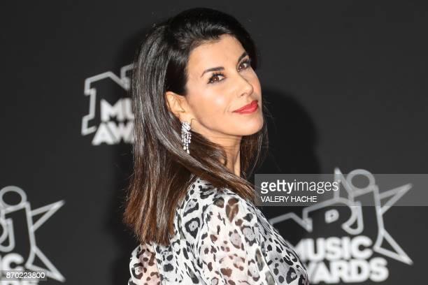 French actress and film director Reem Kherici poses upon her arrival to attend the 19th NRJ Music Awards at the Palais des Festivals in Cannes...