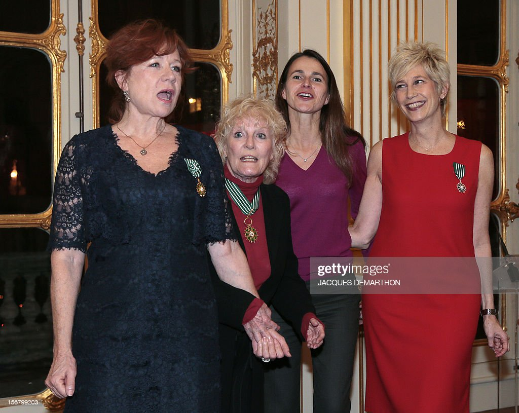 French actress and film maker Eva Darlan (L), British singer Petula Clark (2ndL) and French radio host and former singer Valli (R) pose with French Culture Minister Aurelie Filippetti (2ndR) after been awarded as Knight for Darlan and Valli and Commander for Clark, in the Order of Arts and Letters during a ceremony at the ministry in Paris, on November 21, 2012. DEMARTHON
