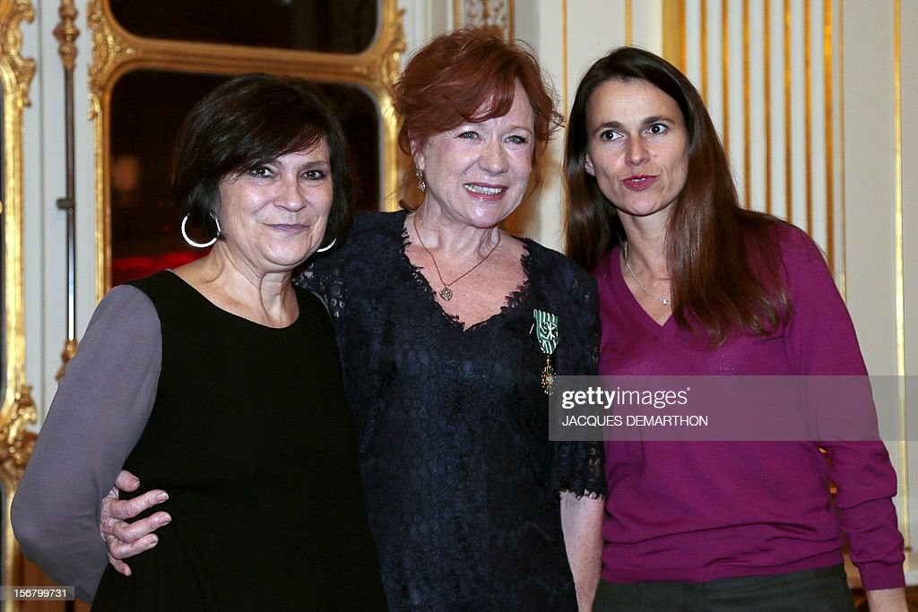 French actress and filmmaker Eva Darlan (C) poses with Deputy Social Affairs Minister Marie-Arlette Carlotti (L) and French Culture Minister Aurelie Filippetti on November 21, 2012 after receiving the knight of the Order of Arts award during a ceremony at the Culture Ministry in Paris.