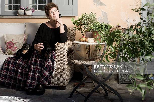 French actress and foremer Bond Girl in 1979 James Bond film Moonraker Corinne Clery poses with her dogs in her countryhouse in Tuscania Italy