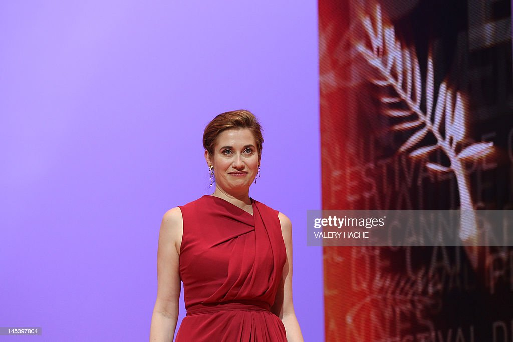 French actress and member of the Jury Emmanuelle Devos arrives on stage during the closing ceremony of the 65th Cannes film festival on May 27, 2012 in Cannes.