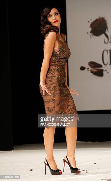 French actress and singe Fabienne Carat presents a chocolate creation by JeanPaul Benielli and Patrice Chapon during the 22nd Chocolate Fair 2016...