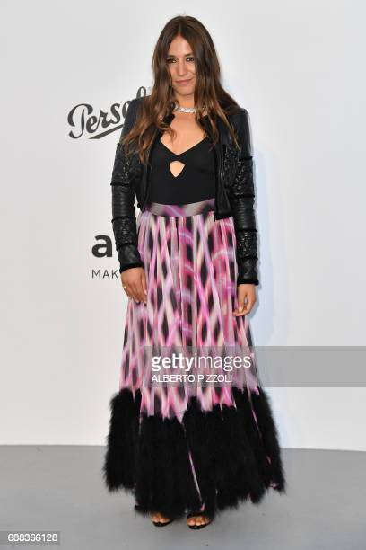 French actress and singer Izia Higelin poses as she arrives for the amfAR's 24th Cinema Against AIDS Gala on May 25 2017 at the Hotel du CapEdenRoc...