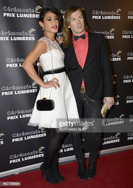 French actress and singer Josephine Jobert and French fashion designer Christophe Guillarme pose as they arrive for the 20th Lumieres awards ceremony...