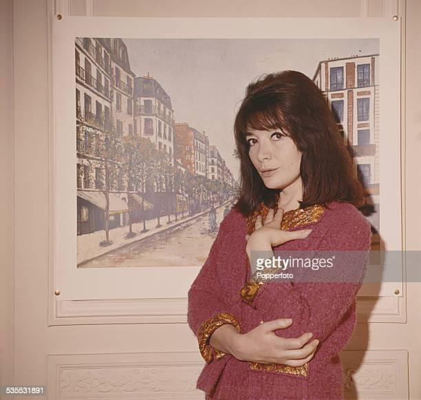 French actress and singer Juliette Greco pictured wearing a pink jacket in 1962
