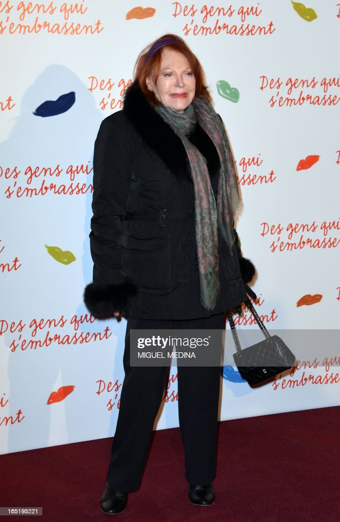 French actress and singer Regine poses while arriving to attend the premiere of the movie 'Des gens qui s'embrassent' (People kissing) by French director Daniele Thompson, on April 1, 2013 in Paris.